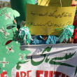 Children supporters of Tehreek-e-Minhaj-ul-Quran chant slogans in favor of Minhaj-ul-Quran International - Stock Photo