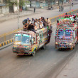 Passengers travel on an overload bus due to non-availability of passenger buses in Karachi — Stock Photo