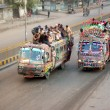 Passengers travel on an overload bus due to non-availability of passenger buses in Karachi — Stock Photo #17654759
