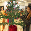 Girls busy in decorating Christmas tree during Celebration ceremony of Christmas ahead of Christmas Day — Stock Photo