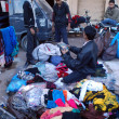 Постер, плакат: Shopkeepers packing garments that rescued after fire erupted due to electric short circuit in cabin shops