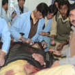 Stock Photo: Paramedic staff busy in treatment of firing victims after firing by unidentified gunmen on police check post