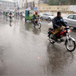 Stock Photo: Commuters pass through road near ShimlHill during downpour of winter season