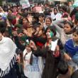 Supporters of AmIttehad and South AsiPartnership Pakistchant slogans in favor of Peace in Country and killing of Polio vaccination workers — Stock Photo #18180311