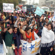 Supporters of AmIttehad and South AsiPartnership Pakistchant slogans in favor of Peace in Country and killing of Polio vaccination workers — Stock Photo #18180325