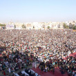 Stock Photo: Supporters and Activists of MuttehdQaumi Movement (MQM) listening addresses of Minhaj-ul-QurInternational President, MulanTahir-ul-Qadri