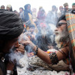 Devotees smokes hashish in sulfi at the shrine of Data Ganj Bakhsh on occasion of the Annual Urs celebrations of Hazrat Data Ganj Bakhsh (RA) - Stock Photo
