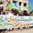 Stock Photo: Activists of Jamat-e-Islami chant slogans against militants mortars shelling in Bartehsil during protest demonstration