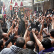 Shiite Muslims mourners participate in religious procession in connection of Chehlum (Fortieth Day Mourning Commemoration), — Stock Photo