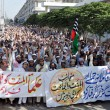 Stock Photo: Activists of Ahle Sunnat Wal Jamat (Defunct Sipah-e- Sahaba) chant slogans against assassination attack on their leader, Aurangzeb Farooqi