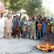 Residents of Qasimabad burn tyres as they are protesting against shortage of drinking water in their locality, during a demonstration — Stock Photo
