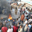 Residents of Talab No. 03 burn tyres as they are  protesting against shortage of Sui Gas - Stock Photo