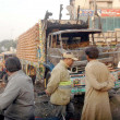 Stock Photo: Gather near truck that caught fire due to electric short circuit, near AishManzil area