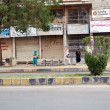 Постер, плакат: View of closed shops after clash between two groups at Rabia City in Gulistan e Johar