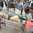 Stock Photo: Shift dead bodies of firing victims, who were killed by undefined gunmen at Quetta