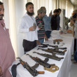 Stock Photo: CID Police officials show seized weapon that recovered from activists of defunct Tehreek-e-Talibduring raid in Muhammad KhColony