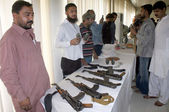 CID Police officials show seized weapon that recovered from activists of defunct Tehreek-e-Taliban during a raid in Muhammad Khan Colony — Stock Photo