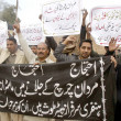 Christians community chant slogans against non arrests of accused who involved attack on Mardan church — Stock Photo