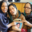 Stock Photo: Relatives mourn during funeral prayer of MuttehdQaumi Movement Sindh Assembly Member, Manzar Imam