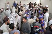 Gather near dead body of three seminary teachers, Mufti Hameed Deenpuri, Mufti Saleh and Mufti Hasan who assassinated by unidentified gunmen — Stock Photo