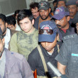 Police officials escorting Shahrukh Jatoi as he is taken by the medical board tasked to determine his age at Civil Hospital in Karachi — Stock Photo