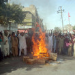 Residents of Old Sabzi Mandi area burn fire and blocked the road as they are protesting against non availability of drinking water and load shedding of electricity - Stock Photo