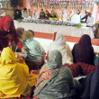 Foto de Stock  : Women recite Naat during Mehfil-e-Milad program in connection of JashEid Milad-un-Nabi (PBUH) organized by Social Welfare Department