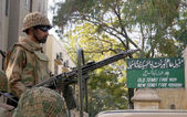 Security officials stand alert as the Pakistan Army troops continue to provide secure environment to Election Commission staff — Stock Photo