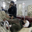 Victim of Orakzai Agency bomb blast being admitted at Lady Reading Hospital for treatment - Stock Photo