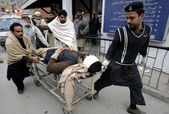 Victim of Orakzai Agency bomb blast being shifted at Lady Reading Hospital for treatment — Stock Photo