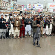 Постер, плакат: Activists of Jamat ud Dawa offer absence funeral prayer of Kashmiri Leader Afzal Guru
