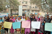Residents of Gulab Channa Goth chant slogans against Land Mafia during a protest demonstration — Stock Photo