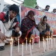 Stock Photo: Activists of Civil Society lighten candles to express Solidarity with HazarCommunity of Quettas they are protesting against bomb blast at grocery market