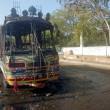 View of burnt bus that torched by unidentified persons at Corridor III near Peoples Secretariat - Photo