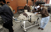 Dead body of victim, who lost his live in bus accident that fall into canal at Charsadda road — Stock Photo