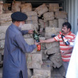 Stock Photo: Customs officials show seized illegal imported liquors bottles that were recovered by PakistMaritime Security Agency during anti smuggling operation