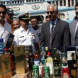 Stock Photo: Customs officials show seized illegal imported liquors bottles that were recovered by PakistMaritime Security Agency