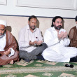 Muslim League Functional Leader, Pir Zada Hashim Sain along with Majlis-e-Wahdat-e-Muslimeen Leader, Kamran Taimoori offers Fateha (Pray) for the victims of bomb blast — Stock Photo