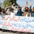 Members of Khyber PakhtunkhwAdhoc Lecturers Association chant slogans for regularization on their jobs — Stock Photo #21977737