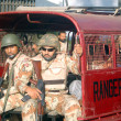 Постер, плакат: Rangers search operation against criminals in Liyari area in Karachi