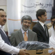 Foto Stock: Federal Health Minister, Zahir Ali Shah distributes laptops to students, on occasion of Convocation Day