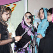Foto Stock: Students participate in tableau on occasion of Universal Women Day