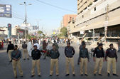 Police official stand alert to avoid any untoward incident as the Shiite Muslims are protesting against Abbas Town tragedy — Stock Photo