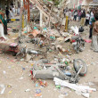 Gather at the site after the bomb explosion at Landhi area in Karachi — Stockfoto