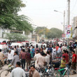 Gather at the site after the bomb explosion at Landhi area in Karachi — Photo