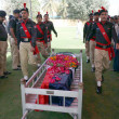 Stock Photo: Police officials present guard of honour to PolicemGul Sher, who was gunned down by unidentified persons