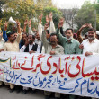 Stock Photo: Members of National Laborers Federation chant slogans against Badami Bagh incident