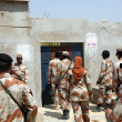 Rangers official are entering in house during targeted search operation led by Sindh Rangers at MehrTown — стоковое фото #22326589