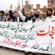 Foto Stock: Activists of Jamat-e-Islami (Chitral) chant slogans against outgoing Khyber Pakhtunkhw(KP) and Chitral governments