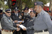 Sindh Police Additional Inspector General, Ghulam Shabbir Sheikh awarding certificates to the police officials who showed their outstanding efforts while on duty, — Stock Photo